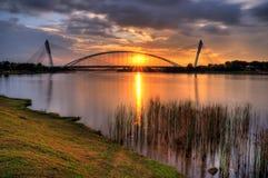 Sunset Through a Bridge Stock Photo