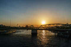 Sunset at  with bridge across the river Stock Photography