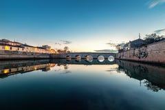 Sunset bridge background. Twilight cityscape Rimini. Rimini ancient Tiberius bridge sunset. Cityscape royalty free stock photo