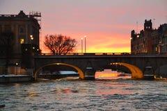 Sunset from a Bridge in Gamla Stan. Colorful bridge in Gamla Sta Stock Photo