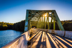 Sunset on a bridge over Prettyboy Reservoir, in Baltimore County Royalty Free Stock Images