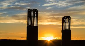 Sunset Bridge Piles. Two new Bridge pile supports at sunset stock images