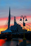 Sunset by the bridge. Sunset at the Riel Esplinade bridge over the Red River in Winnipeg stock photos
