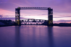 Sunset, bridge and two lighthouses Stock Photos