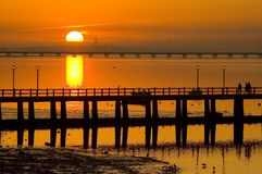 Sunset Bridges. Sunset at River Tagus Estuary close to Lisbon, Portugal, EU. This is a winter picture concerning the mild climate of Portugal Royalty Free Stock Image