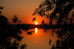 Sunset. The bright sunset over the lake at quiet spring evening Stock Photo