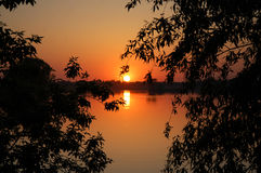 Sunset. The bright sunset over the lake at quiet spring evening Royalty Free Stock Photo