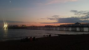 Sunset in Brighton ,pier, sea view. Royalty Free Stock Image