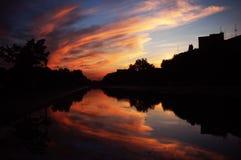 Sunset in Bucharest. Beautiful sunset in Bucharest near Dambovita river Royalty Free Stock Photo