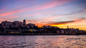 Sunset in Budapest. Buda Castle and the Chain Bridge on the Danube in the sunset Royalty Free Stock Images