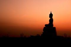 Sunset and Buddha Stock Photos