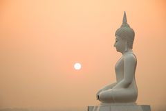 Sunset and Buddha Stock Image