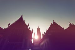 Sunset at buddhist building, silhouette of the chapel and pagoda Stock Photo