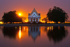 Sunset Buddhist countries, place of practice. Churches Buddhist reflection, sun, meditation garden, a major Buddhist architecture Royalty Free Stock Photo