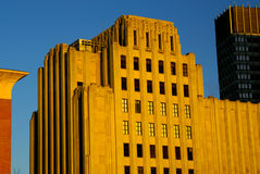 Sunset building. The warm glow of sunset on old art deco building in boaton Stock Images