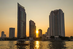 Sunset at building in city Royalty Free Stock Photos
