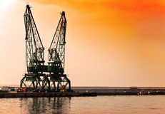 Sunset building crane Stock Photo