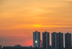 Sunset building. Sunet behind building in bangkok Royalty Free Stock Images