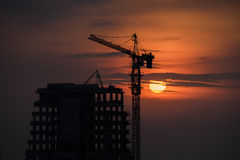 Sunset on the building under construction Royalty Free Stock Image