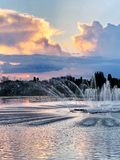 Sunset on the Bujtos lake with fountain. royalty free stock images