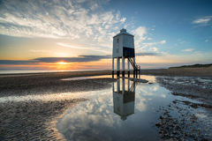 Sunset at Burnham on Sea. Stunning sunset sky over the wooden lighthouse on stilts at Burnham on Sea on the Somerset coast stock photos