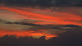 Sunset burning orange clouds timelapse stock footage