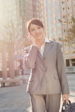 Sunset business woman on cellphone Royalty Free Stock Photo
