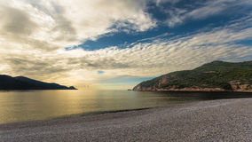 Sunset at Bussaglia beach near Porto in Corsica Royalty Free Stock Images