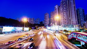 Sunset Busy Traffic. Wide Tilt Up Shot. Hong Kong rush hour sunset timelapse. Residential buildings at the back. Commercial billboards at both sides of the stock video