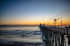 Free Sunset By Oceanside Pier, Palms And The Pacific Oceanin The Famous Surf City In California USA Stock Image - 139604261