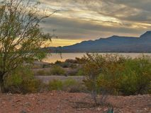 Sunset at Caballo Lake in New Mexico. The Caballo Mountains silhouette against the southwest sky behind Caballo Lake in southern New Mexico stock photography
