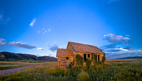 Sunset Cabin in Idaho. Sunset rays strike an aging cabin in the vast wilderness of Idaho Royalty Free Stock Photo