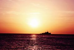 Sunset at Cafe Del Mar- Ibiza. Sailing ship silhouette in the sunset light Royalty Free Stock Image