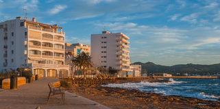 Sunset on the Cafes on Ibiza beaches.  Golden glow as the sun goes down in St Antoni de Portmany Balearic Islands, Spain Royalty Free Stock Image