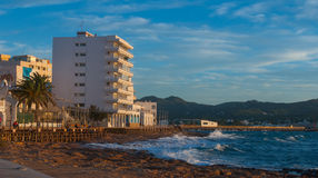 Sunset on the Cafes on Ibiza beaches.  Golden glow as the sun goes down in St Antoni de Portmany Balearic Islands, Spain Stock Photos