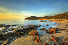 Sunset in Cala Violina bay beach in Maremma, Tuscany. Mediterran Royalty Free Stock Photo