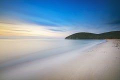 Sunset in Cala Violina bay beach in Maremma, Tuscany. Mediterran Royalty Free Stock Image