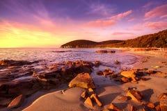 Sunset in Cala Violina bay beach in Maremma, Tuscany. Mediterran Royalty Free Stock Images