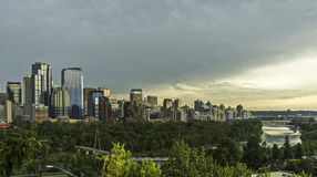 Sunset on Calgary skyline. And Bow River seen from Prince`s Island Park royalty free stock images