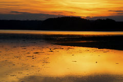 Sunset on a calm lake. Royalty Free Stock Image