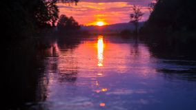 Sunset at calm river, closeup. Sunset at calm river, tranquil scene with moving water and setting sun, Severskiy Donets river, Ukraine stock video