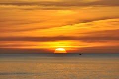 Sunset on a calm sea Stock Photo
