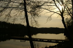 Sunset on calm small lake Royalty Free Stock Image