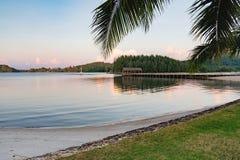 Sunset on the calm Thai beach Stock Photo