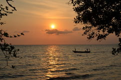 Sunset in Cambodia. Kep,Cambodia. Fishing boat returns at sunset Stock Images