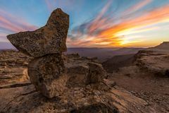 Sunset - Camel Mountain, Mitzpe Ramon, Israel. An amazing colorful sunset viewed near the Camel Mountain in Mitzpe Ramon, Israel. The wide-angle perspective Stock Photo