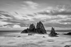 Sunset at Camel Rock. Sunset and long exposure to draw out all the colour in the clouds as the afternoon sun sets to the west at Camel Rock, Australia. The stock photos