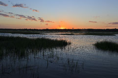 Sunset on the Canal. Sun setting over the canal waters at Cherry Grove Beach in South Carolina Stock Photos