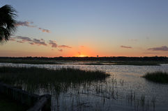 Sunset on the Canal. Sun setting over the canal waters at Cherry Grove Beach in South Carolina royalty free stock images