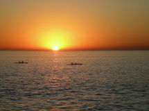 Sunset with canoes Stock Photo
